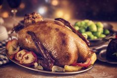 If you want something different this holiday season, this Christmas roast goose recipe is perfect for an Irish Christmas dinner. This Christmas roast goose recipe is the ideal alternative to Christmas turkey. Wild Game Recipes, Duck Recipes, Christmas Roast Goose, Roast Goose Recipes, Cooked Goose, Recipe Icon, Roasted Turkey, Holiday Recipes, Hanukkah Recipes