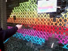 Have you ever seen cross stitch street art? Artist Urban X Stitch weaves strips of fabric to create this colorful and whimsical street art. Yarn Bombing, Graffiti, Cross Stitching, Cross Stitch Embroidery, Fence Weaving, Guerilla Knitting, Instalation Art, Summer Art Projects, Grades