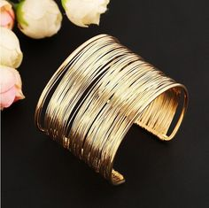 Boho Chic Wire Wrapped Bangle Bracelet Tribal Accessories Gypsy Jewelry Lead and nickel free alloy based metal One size Select Silver or gold Free worldwide shipping on all orders! Like us on Facebook