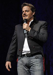 """Edward John """"Eddie"""" Izzard (born 7 February 1962) is an English stand-up comedian, actor, and writer. His comedy style takes the form of rambling, whimsical monologue and self-referential pantomime. He IS my favorite entertainer. If you don't know about Eddie, try to do so ASAP."""
