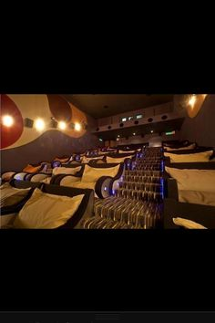 Movie theater with cuddle seats. Maybe home theater idea?
