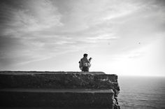 Chinese traveler shooting the sea on the South West Coast Path in Devon, England