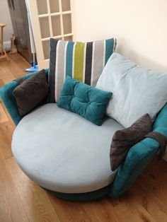 This swivel snuggler was purchased for a large kitchen dining room, partly to help zone the space to avoid everything facing the TV.  The splash backs were a strong turquoise, which inspired the colour theme selected.