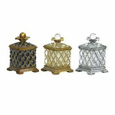 """Set of 3 glass boxes with floral finial tops and latticed details. Product: Set of 3 trinket boxes Construction Material: Glass and composite wood Color: Black, gold and silver   Dimensions: 5.5"""" H x 3.5"""" W x 3.5"""" D"""