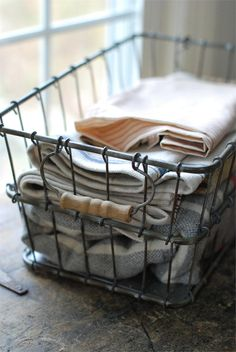 Vintage Style Farmhouse Wire Basket for handtowels in the bathroom, instead of them being rolled up in a basket... or dishtowels in the kitchen