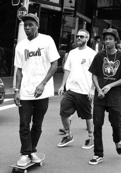 Odd future And their manager Clancy I really enjoy this photo of Tyler, the creator and Taco Bennett because it shows what they have as a family of musically inclined skaters and really it doesn't matter what the hell you look like as long as you have solar Interests you belong where they do.