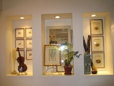 I love this idea of niche displays for antiques, statue, or beautiful vase. Love the recessed lights, too.