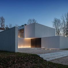 Via thehardt DM Residence by CUBYC architects bvba situated in Flanders, Belgium. The facades of the 7,696 ft² (715 m²) home are clad with ceramic tiles, in random vertical strips due to maintainability in a wooded area. The tiles give the house a burst of white in the rather dark wood. The ceramic tiles gave us the opportunity to use them consequently in facades, inner and outer flooring. #Belgium #Belgian #Architecture #Minimal #simple #simplicity #composicion #precision