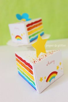 Customized rainbow cake favor boxes = awesome!  I want to do cupcakes as favors.