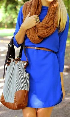 Lovely fashion look in shinning blue dress and scarf