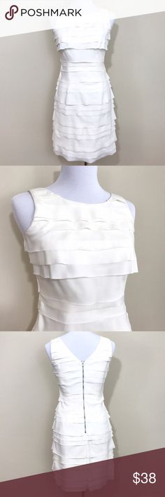 Gianni Bini White Tiered dress Gianni Bini White Tiered dress in excellent condition. No stains. Back zipper and luxurious satin-like lining. Perfect for a dressy event or semi-formal. Size 2. Gianni Bini Dresses