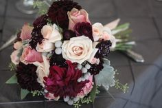 love the richness of the deep burgundy against the pastels