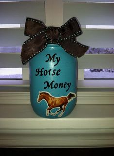 Saving for a horse....Mason Jar painted and add stickers an some ribbon and you have a money jar.