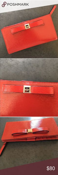 Kate Spade Red Leather Bow Wallet Red Leather Gold tone hardware Inside 12 credit card slots, 4 billfolds, 1 ID window Snap closure Measures approximately 6 3/4 (L)'' x 3 1/2 (H)'' kate spade Bags Wallets