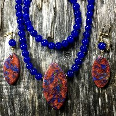 Polymer clay opals strung on blue agate.