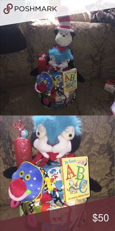 Unisex cat in hat diaper cake Dr Seuss blanket  Dr Seuss abc book Bottle Stuff multicolor rattle  Stuff cat in hat with thing one n two Thing one n two onesie  Plastic cat in hat thing 1 figure Huggie or luv diapers  Wrap in plastic with ribbon Accessories