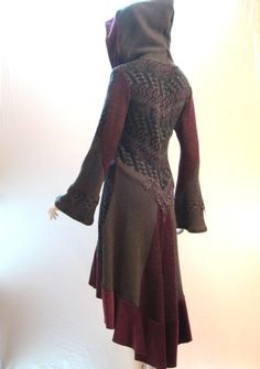 Sweater coat made from a smaller sweater by extending the sleeves and the bottom.  beautiful back!