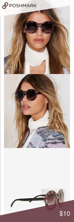 """#37 nasty gal  Don't resign to the sunshine. The Hold the Shine Shades come in a gray, brown, and lavender abstract print and feature double brow bar design and gray ombré lenses. Pair them with a dark, matte lip and plunging romper.  *Synthetic Materials  *5.5""""/14cm width  *2.5""""/6.5cm height Nasty Gal Accessories Glasses"""