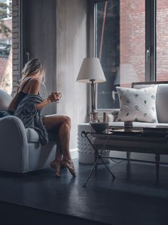 28 Sublime - Astonishing Home Interior And Decor Ideas : Staggering woman sitting on gray sofa chair holding mug