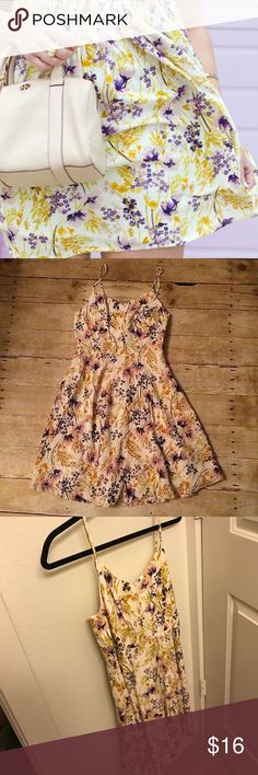 Old navy purple + yellow floral sun dress Worn once! Near perfect condition! Lined, elasticized top back, flowy skirt. Adjustable straps. Super comfy and chic! Old Navy Dresses
