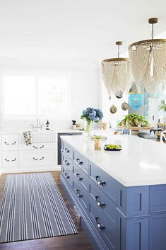 Oversized pendant lighting adds drama to the space. Hamptons House, The Hamptons, Hawaiian Homes, Interior Decorating, Interior Design, Decorating Ideas, Charleston Homes, Kitchen Room Design, New Homes