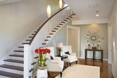 Sherwin Williams SW 7568 Neutral Ground up the stairs and Comfort Gray in foyer