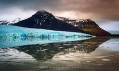 """Triangulation - Crazy, ever-changing weather was upon us the day we visited the Mountain Lagoon during my first 2013 'Land of Ice' workshop. It was raining quite hard, but then the clouds gave way for a few minutes, creating peach-colored, ominous light on the lagoon and its glacier, Fjallsjökull.  If you'd like to experience and shoot these amazing locations under my dedicated guidance, please check out my upcoming '<a href=""""http://erezmarom.com/news/index.php?NewsID=29"""">Land of Ice</a>'…"""