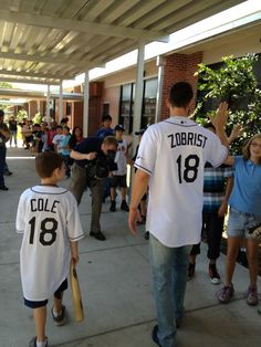 """Ryan Cole the winner of """"Take Zobrist to School"""" sponsored by Metro PCS escorts Ben Zobrist into his 4th Grade classroom at Ponce De Leon Elementary today! Not a bad day at school."""