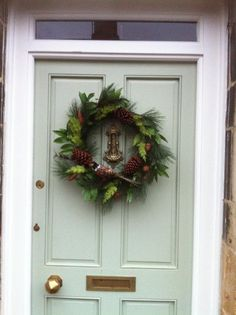 A front door painted in Farrow & Ball Vert De Terre, beautifully complements the darker shades of this advent wreath Country Front Door, Front Door Entryway, Exterior Front Doors, Exterior Paint, Farrow Ball, Christmas Colors, Christmas Time, Painted Front Doors, Front Door Colors