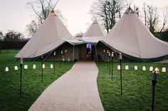 Lizzie and Mark saw the 2015 New Year in with a beautiful tipi wedding at the gorgeous country venue of Boxted Hall, in Suffolk. Think classy, gatsby-esque styled tipis, with fun touches of NYE glitz and sparkle throughout. We love a sparkler send-off! Tipis by beautifulworldtents.co.uk, photography by jezdicksonphotography.co.uk
