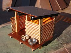 A very modern dog house.      -------   this would also be great for the neighborhood stray cats