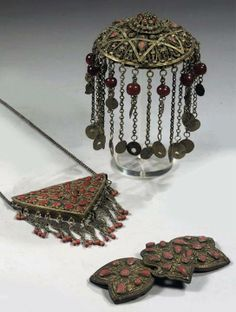 Turkey: an Ottoman coral inlaid silver filigree headpiece, belt buckle and pendant; 19th c.