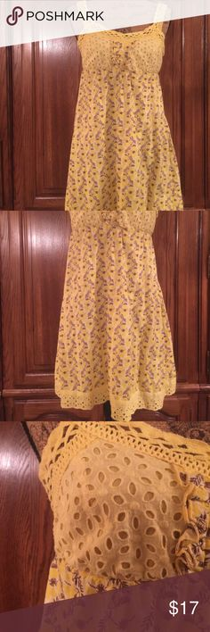 """Sans Souci Baby Doll Sundress Gently worn size medium made of 100% cotton. It has eyelet cotton Lace at the hem and bust. Crocheted straps. It has elastic at the back for more give and security. It measures approximately 16"""" flat underarm to underarm and measures approximately 27.5"""" long measured from top of Dress to hem Sans Souci Dresses"""