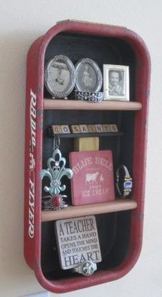 """Small Red Flyer Wagon used as a shadow box wall shelf.  Go to www.coolchairs.net or www.coolcottage.net More pictures coming soon.  This is the small size wagon (weighs about 2-3 pounds).  I recommend this over the larger (34"""" L) wagon which weighs 10# before any items are placed inside.  GO SAINTS"""