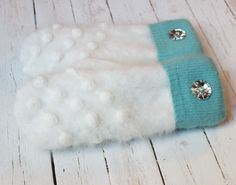 A personal favorite from my Etsy shop https://www.etsy.com/listing/255672728/sweater-mittens-recycled-sweater-mittens