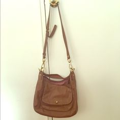 Coach light brown shoulder bag Light brown, gorgeous handbag by Coach. It doubles as a cross body bag, with a detachable strap. Perfect sized handbag. In very good condition. Open to negotiation. Coach Bags Shoulder Bags
