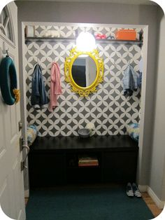 Closet turned entryway / mudroom with wall stencil