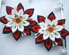 1 pair of HANDMADE kanzashi flower hair clips.The handmade KANZASHI flowers made of grosgrain ribbon are apprx.6 cm.(2.25) in diameter. Mounted on alligator type hair clips, which are 4 cm(1.25) long.    Non-slip - grips are available upon request with no additional charge when you check out. I always use the highest quality ribbon and materials.  All hair accessories made of ribbon and satin fabric are heat sealed to prevent fraying.    My hair accessories are designed by me and made in my…