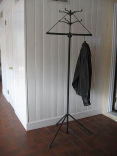 coat rack with a bar for coat hangers! this is getting extravagant.