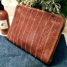 """Vintage Woven Leather Clutch Bag Soft leather clutch with three sided zipper.  Inside zipper pocket.  Clean with only one stain, shown in the photo.  There are also markings where the weave pattern grid was imprinted through.  9 1/2"""" x 7 1/2"""".  Good condition. Bags Clutches & Wristlets"""