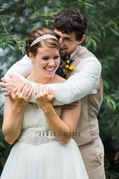 Romantic and rustic Wisconsin wedding - country bride and groom - Wisconsin wedding photographer - love and romance - outdoor wedding photos - lace wedding dress - khaki grooms suit - www.james-stokes.com