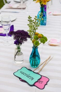 Outdoor Celebration of Love & Colour {Winelands Wedding}   Confetti Daydreams - Colourful table name signs and colourful flowers displayed in colourful vases ♥  ♥  ♥ LIKE US ON FB: www.facebook.com/confettidaydreams  ♥  ♥  ♥