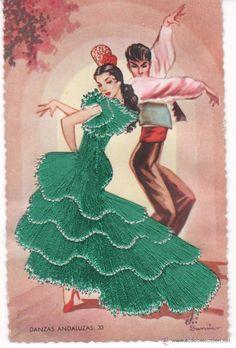 Postal de pareja vestida de flamenca con el vestido bordado a la postal