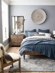 Solid wood and grey. Also, great big plate nordic-blue-and-grey-bedroom-with-wooden-bed-and-furniture-and-blue-and-white-bed-covers-cozy-nordic-look Light Gray Bedroom, Gray Bedroom Walls, Bedroom Red, Small Room Bedroom, Wood Bedroom, Home Decor Bedroom, Bedroom Furniture, Bedroom Ideas, Small Rooms