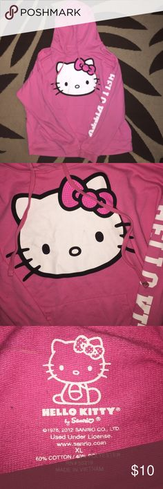 Hello kitty thin hoodie Pink. With hello kitty head( might have a few marks) says hello kitty down the arm. Sanrio brand. Has hood & draw strings. No holes or stains Sanrio Tops Sweatshirts & Hoodies