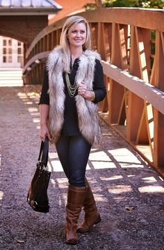 Fall outfit ideas.  Faux fur vest, boots and denim.