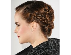 Emma Watson. Instead of going the traditional summer route and wrapping braids around the top of your head, pin them across the back.