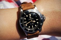 Vintage Rolex Submariner.  Love the black dial and leather strap combo.