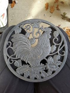 Check out this item in my Etsy shop https://www.etsy.com/listing/473080620/vintage-cast-iron-rooster-trivet-cast