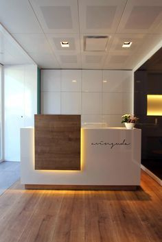 Love this flooring option, again we NEED underlighting, cool glossy white front desk warm but clean